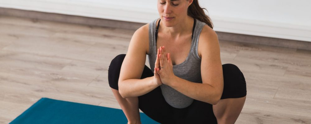 Young,Pregnant,Woman,Doing,Prenatal,Yoga,Posture,With,Namaste,Hands